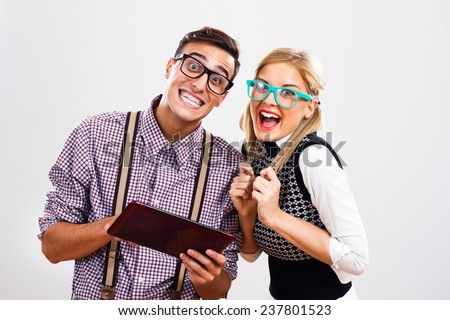Portrait of young nerds using digital tablet,Nerds using digital tablet - stock photo
