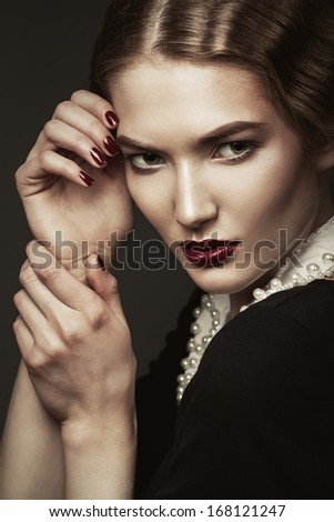 portrait of young old-fashioned woman - stock photo