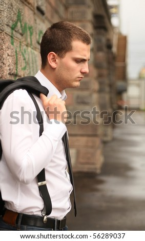 portrait of young pensive student - stock photo