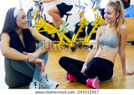 Portrait of young people resting after class in the gym.  - stock photo