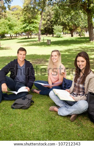 Portrait of young people working in a park - stock photo