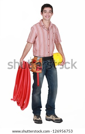 portrait of young plumber all smiles isolated on white - stock photo