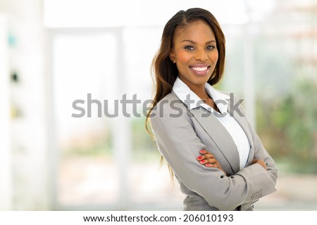 portrait of young pretty african american businesswoman in office - stock photo