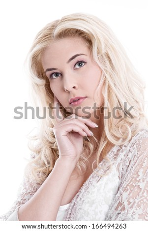 Portrait of  young pretty blond woman thinking on white background - stock photo