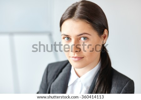 Portrait of young pretty business woman in the office - stock photo