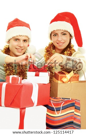 Portrait of young pretty couple holding  red box - christmas gift and looking at camera - stock photo