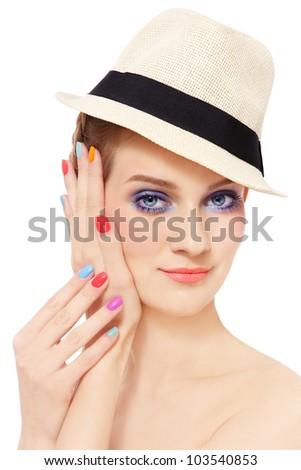 Portrait of young pretty girl in hat, with bright make-up and colorful nail polish, on white background - stock photo