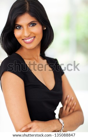 portrait of young pretty indian businesswoman in office - stock photo