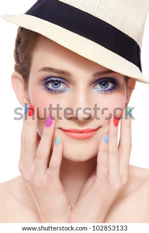 Portrait of young pretty smiling girl with bright make-up and colorful nail polish, on white background - stock photo