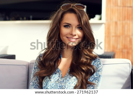 Portrait of young pretty smillng girl. Outdoor summer portrait      - stock photo