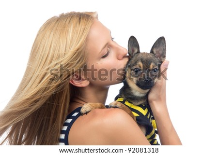 Portrait of young pretty woman kissing small Chihuahua puppy dog isolated on a white background - stock photo