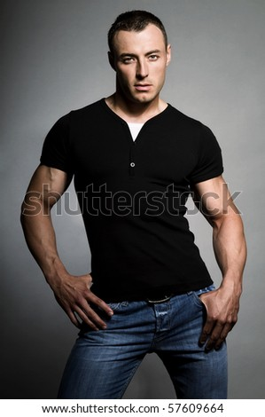 Portrait of young sexy man on grey background. - stock photo