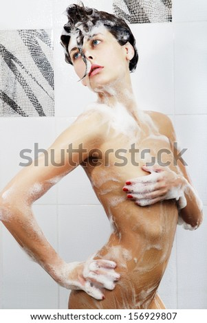 Portrait of young sexy woman with soap foam - stock photo