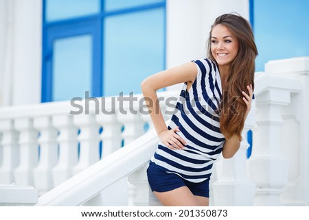 Portrait Of Young Smiling Beautiful Woman. Close-up portrait of a fresh and beautiful young fashion model posing outdoor in sunny weather - stock photo
