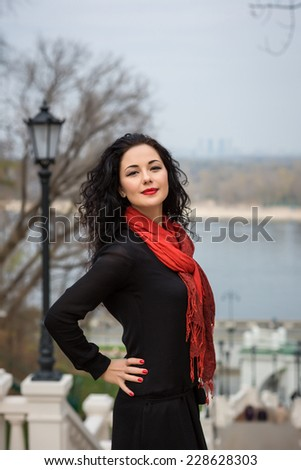 Portrait Of Young Smiling Beautiful Woman in warm autumn day - stock photo