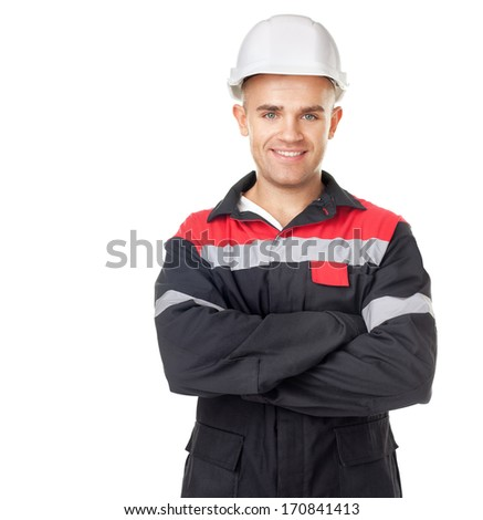 Portrait of young smiling engineer isolated on white background - stock photo
