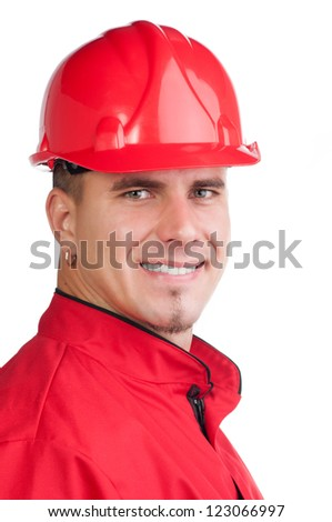 Portrait of young smiling fireman with hard hat and in full uniform isolated on white. - stock photo