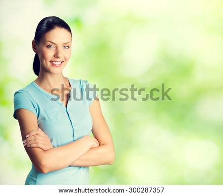 Portrait of young smiling lovely woman, outdoors, with blank copyspace area for text or slogan - stock photo