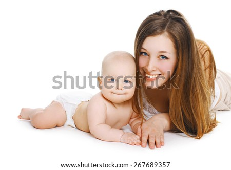 Portrait of young smiling mom and sweet baby together - stock photo