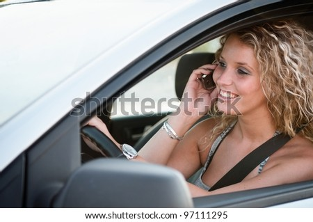 Portrait of young smiling person driving car - stock photo
