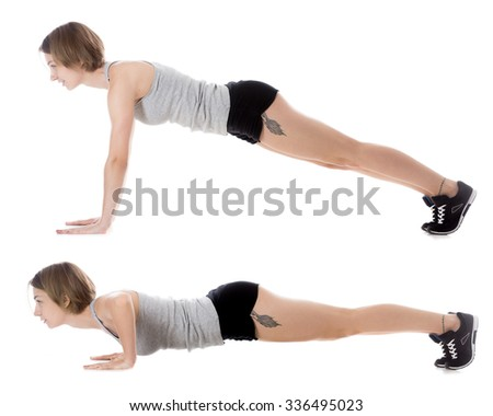 Portrait of young smiling slim beautiful woman doing fitness exercises on mat, warming up, push-ups, full length isolated studio image on white background, side view - stock photo