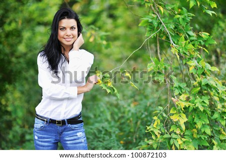 Portrait of young smiling woman outdoor - stock photo