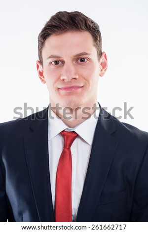 Portrait of young  smilling businessman in black suit and red tie - stock photo