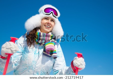 portrait of young smilling woman on ski holiday in mountains  - stock photo