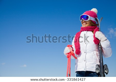 portrait of young smilling woman  on winter holiday outdoor - stock photo