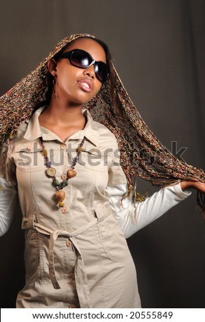Portrait of young stylish african female model with sunglasses - stock photo