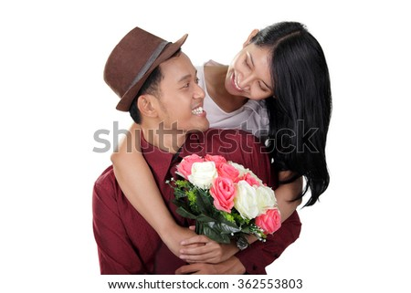 Portrait of young stylish couple smiling at each other, isolated on white background - stock photo
