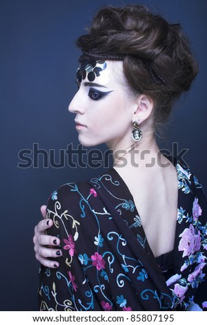 Portrait of young stylish woman with creative visage. - stock photo