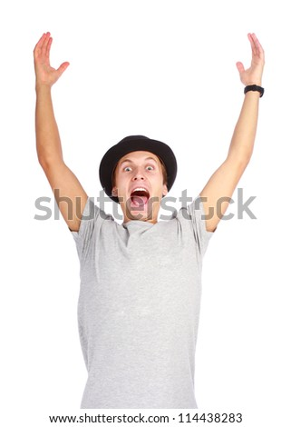 Portrait of young successful man cheering and raising him hands up on white background - stock photo