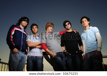 Portrait of young team standing together - stock photo