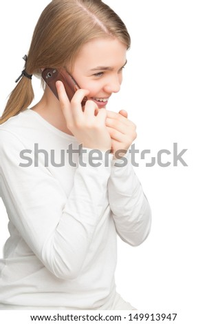 portrait of young teenage girl talking on mobile phone. isolated on pure white background. vertical shot - stock photo