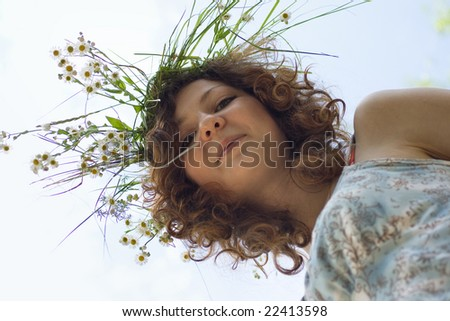 Portrait of young teenage girl with beautiful long curly hair - stock photo