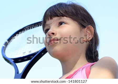Portrait of young tennis player with tennis racket on background of blue sky. - stock photo