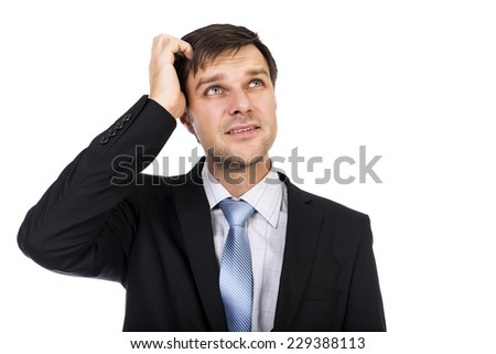 Portrait of young thoughtful businessman isolated over white background - stock photo