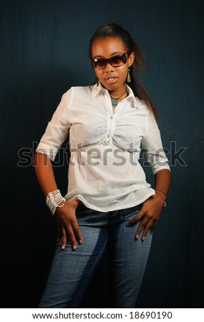 Portrait of young trendy african american girl standing - stock photo