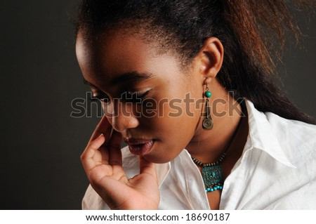 Portrait of young trendy african american girl thinking - stock photo