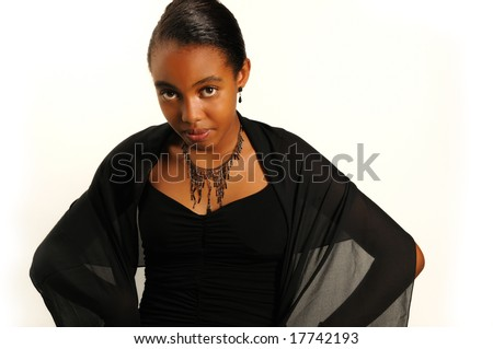 Portrait of young trendy teenage girl wearing elegant evening dress - stock photo