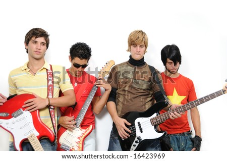 Portrait of young trendy teenager group posing with musical instruments - stock photo