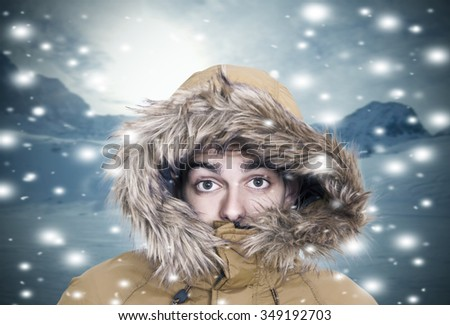 Portrait of young warm in the snow - stock photo