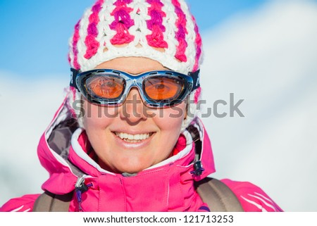 Portrait of young woman a ski outfit at winter outdoor in the Zillertal Arena, Austria - stock photo