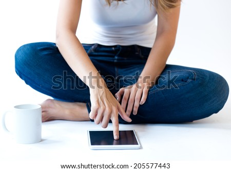 Portrait of young woman at home with digital tablet. Isolated on white. - stock photo