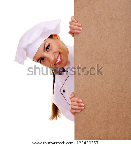 portrait of young woman chef with empty board isolated on white - stock photo