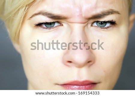 portrait of young woman expressing anger, bad mood  - stock photo