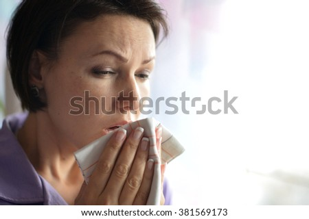 Portrait of  young woman feels sickness at home - stock photo