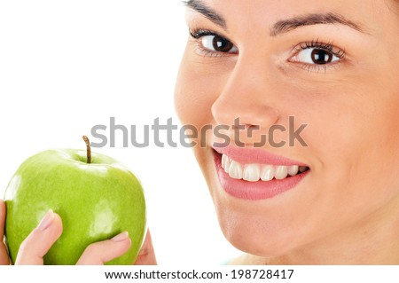 Portrait of young woman holding apple isolated on white - stock photo