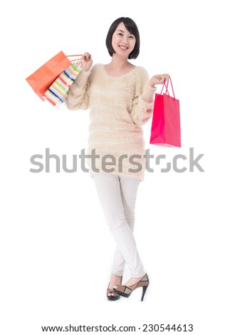 Portrait of young woman holding shopping bags posing - stock photo